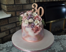 Rose Gold cake with cascading flowers.jpg