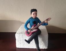 Jack playing guitar USE.JPG